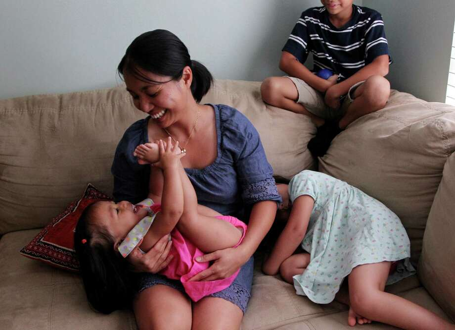 Ivana Beasley, a mother of three, says she shares a bed with her 17-month-old daughter, Indira, whom she nurses at night. She says she takes extra precaution to make co-sleeping safe for her child. Photo: Mayra Beltran, Staff / © 2013 Houston Chronicle