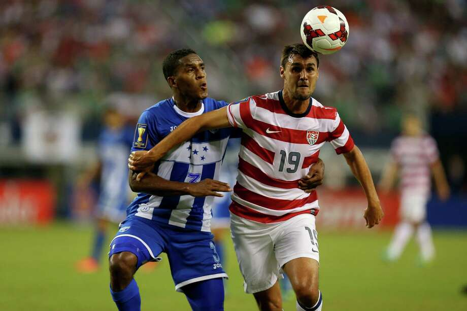 ARLINGTON, TX - JULY 24:  Chris Wondolowski #19 of the United States dribbles the ball against Diego Reyes #7 of Honduras during the CONCACAF Gold Cup semifinal match at Cowboys Stadium on July 24, 2013 in Arlington, Texas. Photo: Ronald Martinez, Getty Images / 2013 Getty Images