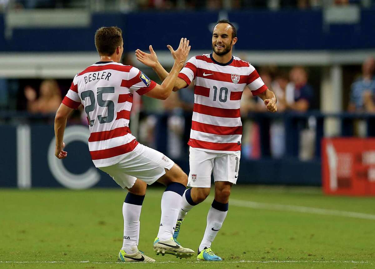 ARLINGTON, TX - JULY 24: Landon Donovan #10 of the United States celebrates his goal with Matt Besler #25 against Honduras during the CONCACAF Gold Cup semifinal match at Cowboys Stadium on July 24, 2013 in Arlington, Texas.
