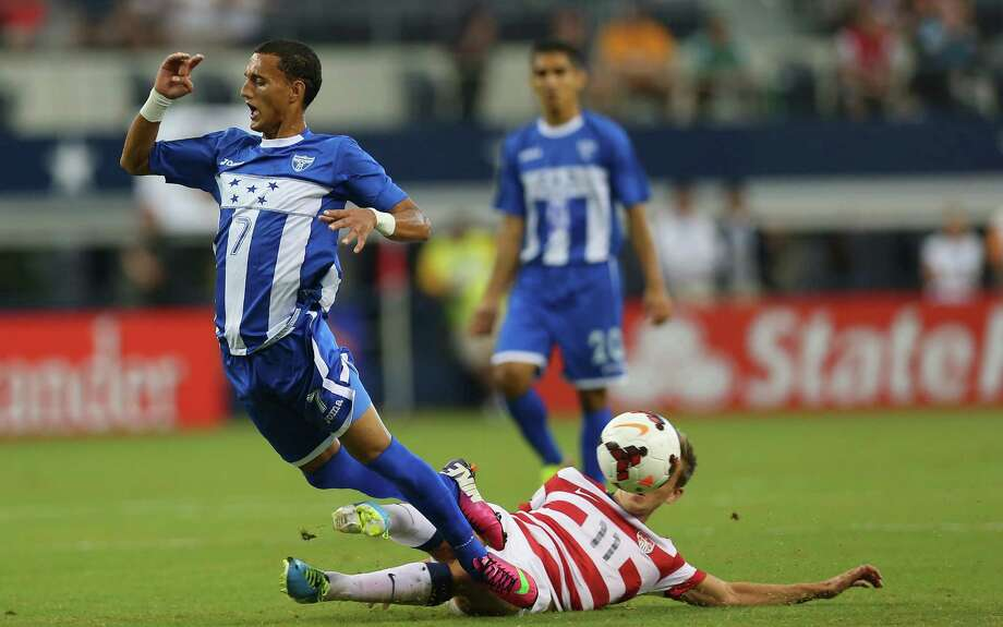 ARLINGTON, TX - JULY 24:  Diego Reyes #7 of Honduras is tripped by Stuart Holden #11 of the United States during the CONCACAF Gold Cup semifinal match at Cowboys Stadium on July 24, 2013 in Arlington, Texas. Photo: Ronald Martinez, Getty Images / 2013 Getty Images
