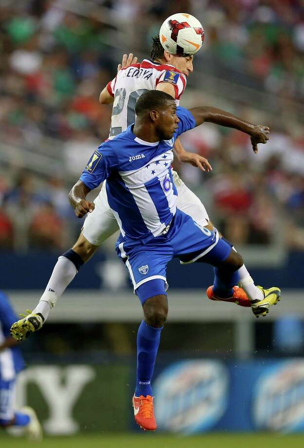 ARLINGTON, TX - JULY 24:  Alejandro Bedoya #20 of the United States jumps for a header with Juan Carlos Garcia of Honduras during the CONCACAF Gold Cup semifinal match at Cowboys Stadium on July 24, 2013 in Arlington, Texas. Photo: Ronald Martinez, Getty Images / 2013 Getty Images