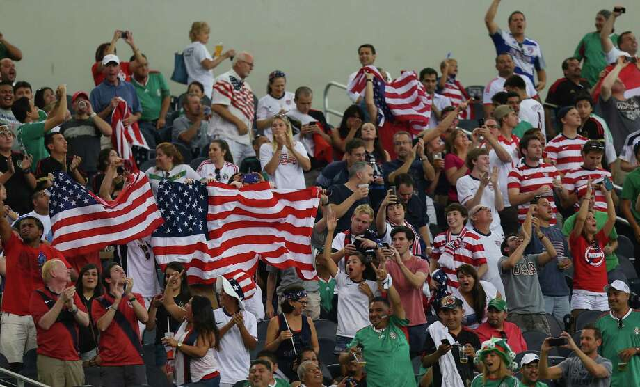 ARLINGTON, TX - JULY 24:  Fans of the United States cheer during the CONCACAF Gold Cup semifinal match at Cowboys Stadium on July 24, 2013 in Arlington, Texas. Photo: Ronald Martinez, Getty Images / 2013 Getty Images