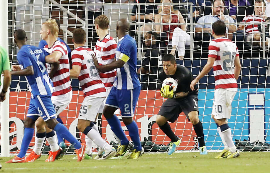United States goalkeeper Nick Rimando (1) collects the ball on a Honduras corner-kick during the second half of the Gold Cup semifinals at Cowboys Stadium, Wednesday, July 24, 2013, in Arlington, Texas. The United States won 3-1. (AP Photo/Brandon Wade) Photo: Brandon Wade, Associated Press / FR168019 AP