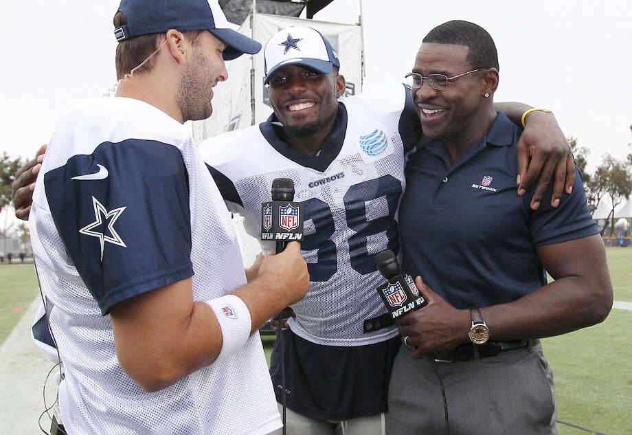 Tony Romo (from left), Dez Bryant and former Cowboy Michael Irvin gather for an interview by Irvin after the afternoon session of the 2013 Dallas Cowboys training camp on Wednesday, July 24, 2013 in Oxnard. Photo: Kin Man Hui, San Antonio Express-News / ©2013 San Antonio Express-News