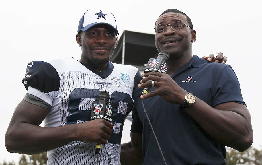 Dez Bryant (left) gets interviewed by former Cowboy Michael Irvin after the afternoon session of the 2013 Dallas Cowboys training camp on Wednesday, July 24, 2013 in Oxnard. Photo: Kin Man Hui, San Antonio Express-News / ©2013 San Antonio Express-News