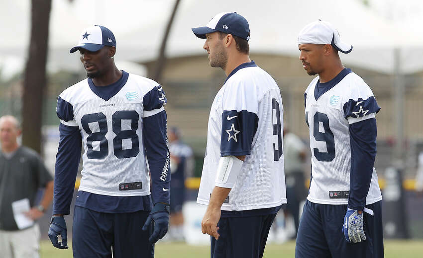 Dez Bryant (from left), Tony Romo and Miles Austin work on plays during the morning session of the 2013 Dallas Cowboys training camp on Wednesday, July 24, 2013 in Oxnard.
