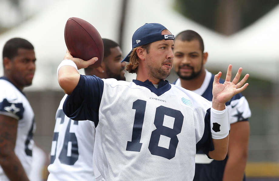 Quarterback Kyle Orton (18) drops back to throw during the morning session of the 2013 Dallas Cowboys training camp on Wednesday, July 24, 2013 in Oxnard. Photo: Kin Man Hui, San Antonio Express-News / ©2013 San Antonio Express-News