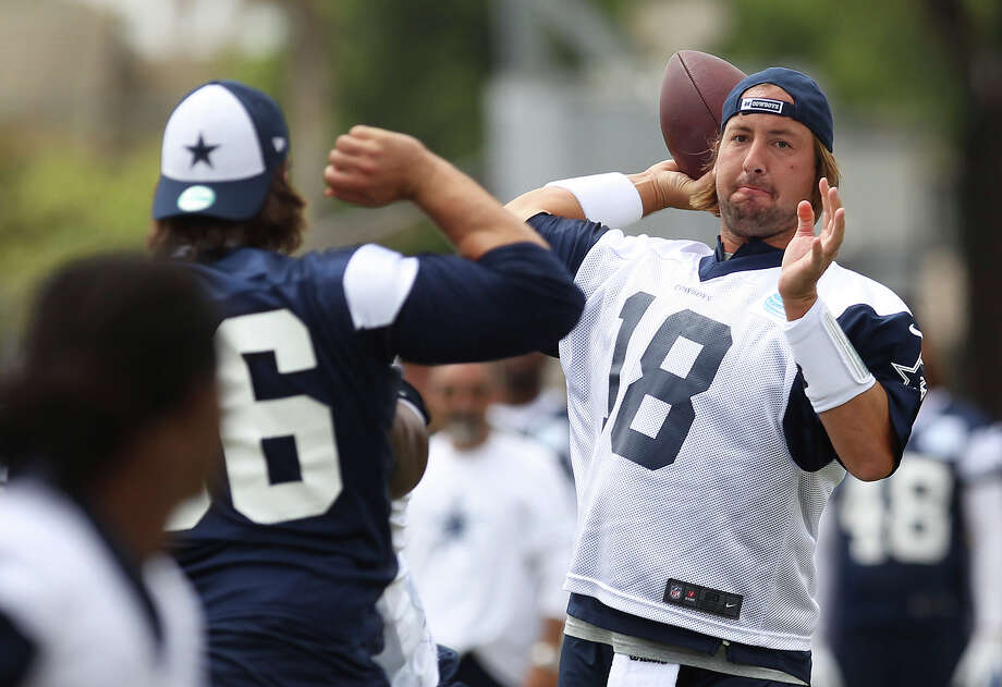 Quarterback Kyle Orton drops back for a pass during the morning session of the 2013 Dallas Cowboys training camp on Wednesday, July 24, 2013 in Oxnard. Photo: Kin Man Hui, San Antonio Express-News / ©2013 San Antonio Express-News