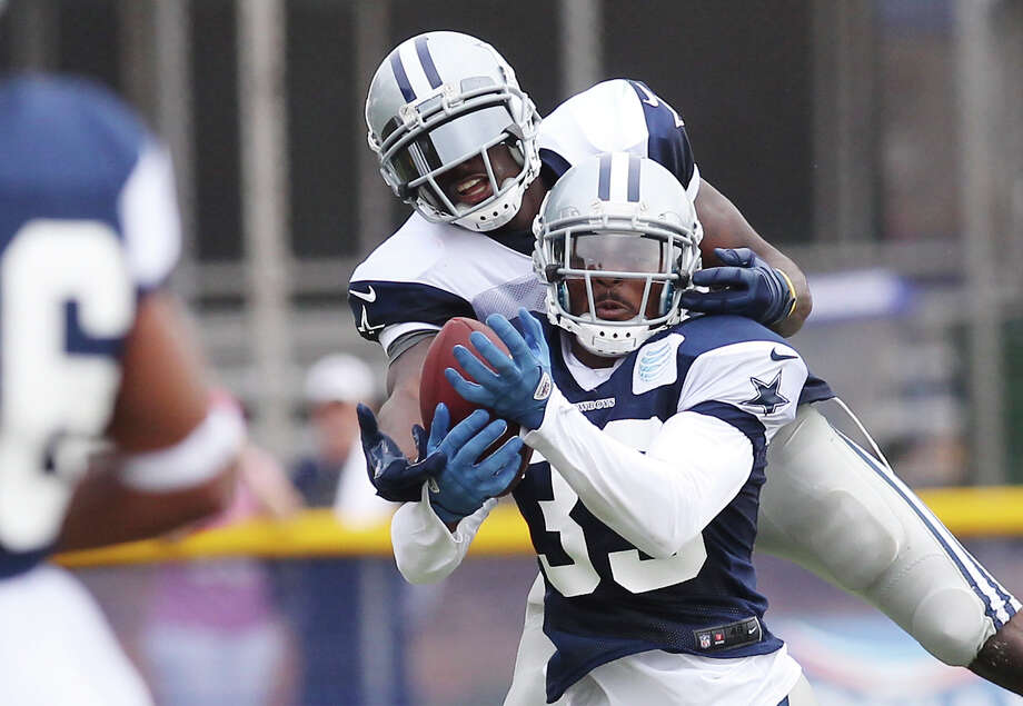 Cornerback Brandon Carr (39) intercepts a pass for receiver Dez Bryant during the afternoon session of the 2013 Dallas Cowboys training camp on Wednesday, July 24, 2013 in Oxnard. Photo: Kin Man Hui, San Antonio Express-News / ©2013 San Antonio Express-News