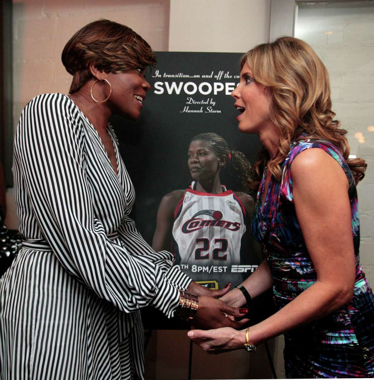 """Former WNBA and Houston Comets star Sheryl Swoopes and ESPN sports journalist and broadcaster Hannah Storm hold hands as they both take a moment in front of the movie poster for """"Swoopes"""" during a reception Wednesday, July 24,2013 at Brasserie 19 in Houston, Texas. Storm directed the ESPN documentary about former WNBA and Comets star Sheryl Swoopes, The film, part of ESPN's """"Nine for IX series"""", airs next week on ESPN. Tonight, both Storm and Swoopes were on hand at a special screening at River Oaks Theatre in Houston, Texas."""