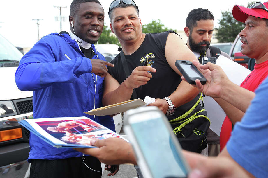 Andre Berto, left, poses with fan, Tony Vasquez, before a light workout in the parking lot of the H-E-B at the corner of South Zarzamora and Military Drive, Wednesday, July 24, 2013. Berto, of Winter Haven, Florida, is fighting in the main card of this Saturday's Knockout Kings II at the AT&T Center. He is fighting Jesus Soto Karass, of Los Mochis, Mexico for the vacant NABF Welterweight title. Photo: JERRY LARA, San Antonio Express-News / © 2013 San Antonio Express-News