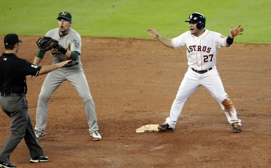 July 24: A's 4, Astros 3 Jose Altuve signals safe as Athletics shortstop Jed Lowrie reacts to the call from the second base umpire. Photo: Billy Smith II, Chronicle