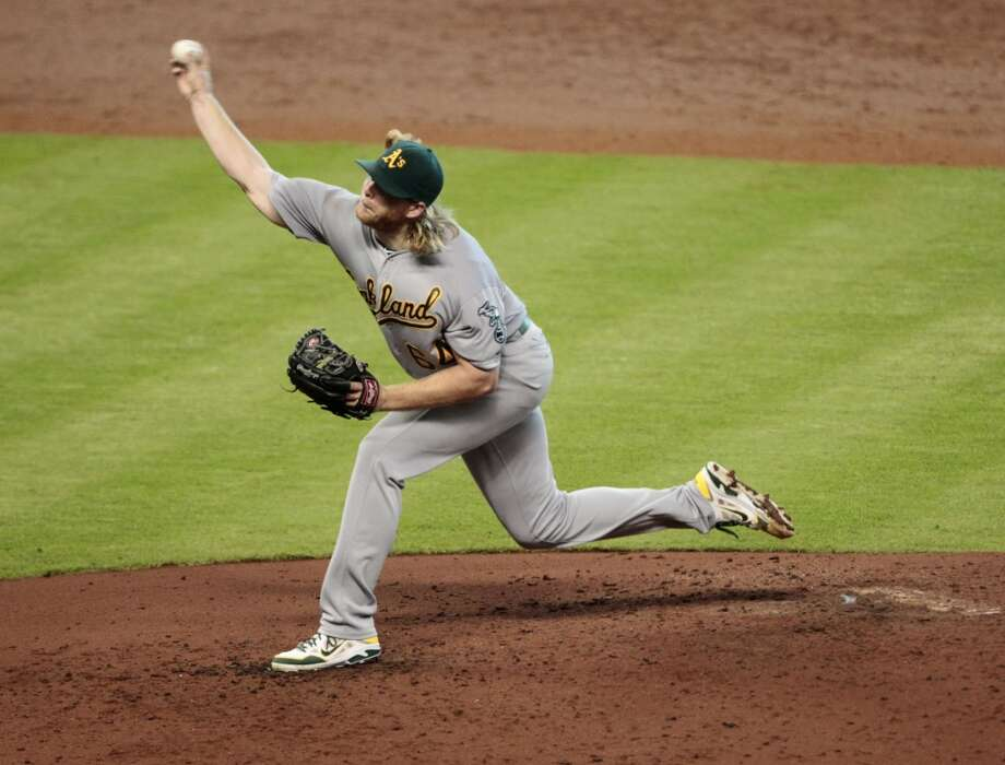A.J. Griffin throws against the Astros in the third inning. Photo: Billy Smith II, Chronicle