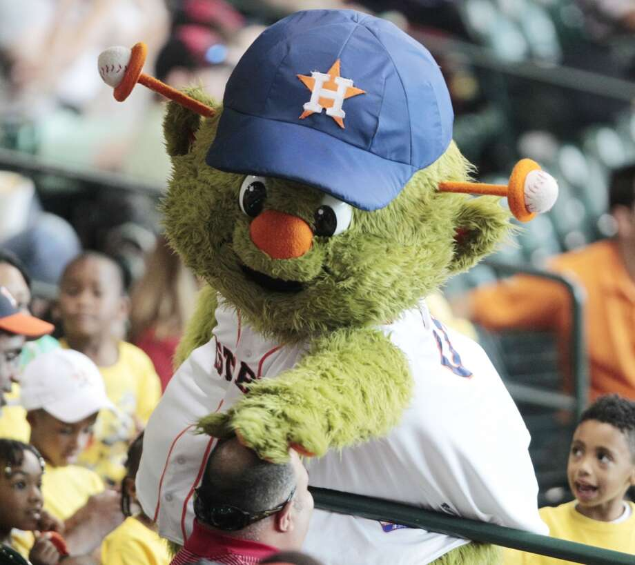 Astros mascot Orbit has some fun with a fan. Photo: Billy Smith II, Chronicle