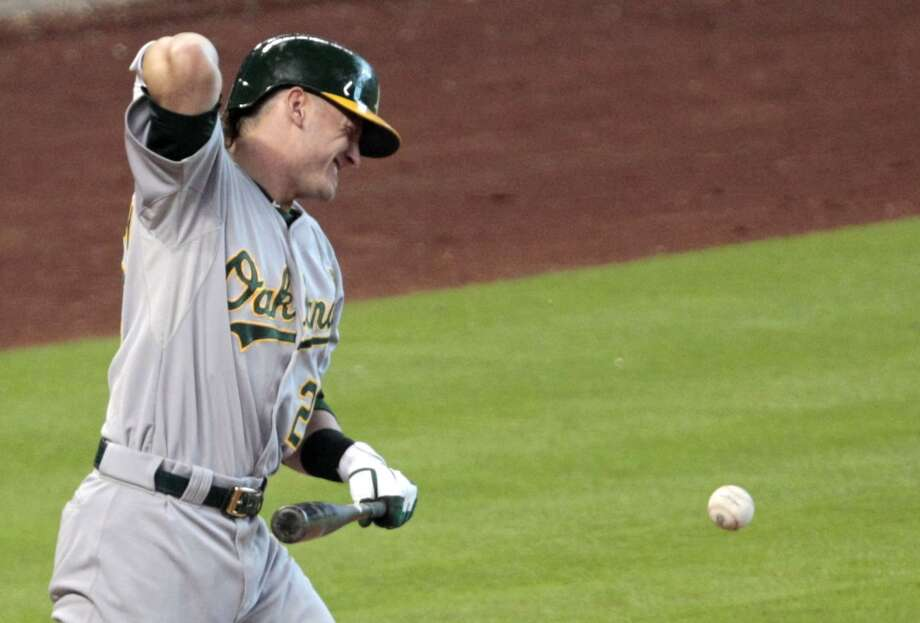 Josh Donaldson reacts after being hit on the elbow  by a pitch from Bud Norris. Photo: Billy Smith II, Chronicle