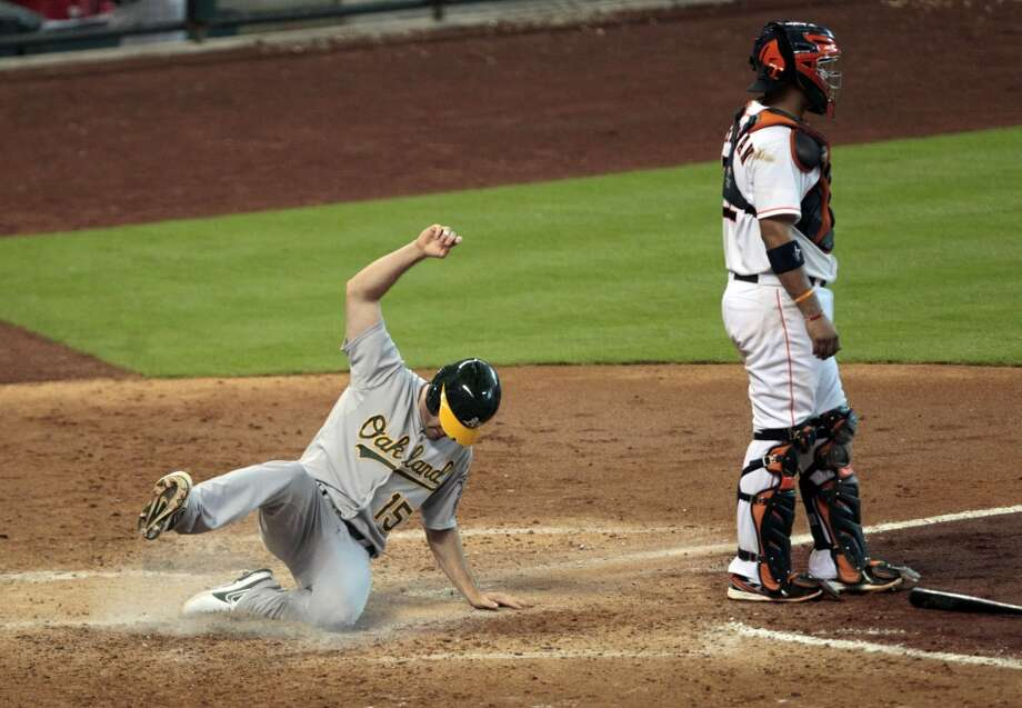 Seth Smith scores off a double by teammate Eric Sogard in the top of the seventh inning. Photo: Billy Smith II, Chronicle