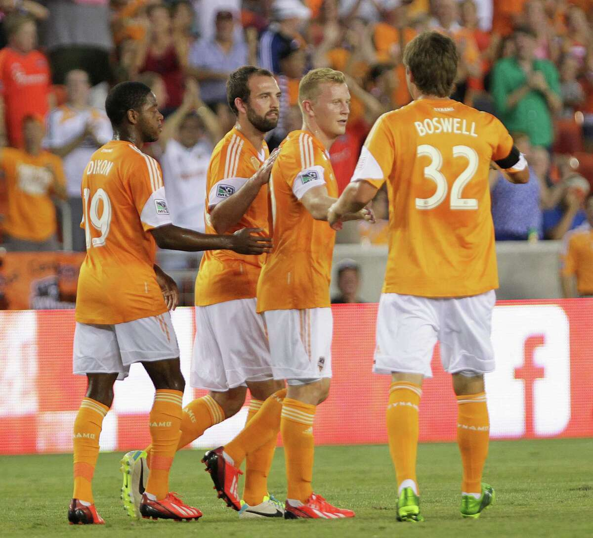 The Houston Dynamo's Andrew Driver 2nd from right, celebrates with teammates after Driver's goal against Stoke City during the first half of the BBVA Compass Dynamo Charities Cup match at BBVA Compass Stadium Wednesday, July 24, 2013, in Houston.