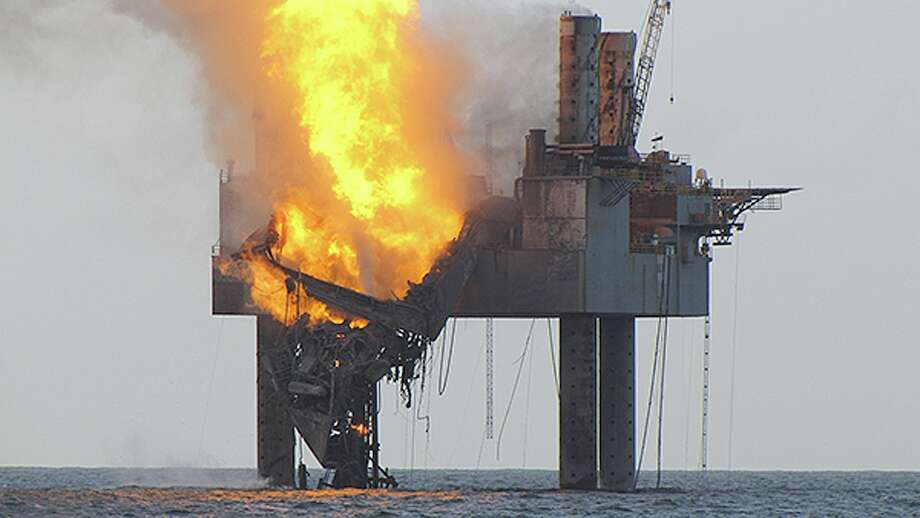 In this Wednesday, July 24, 2013 photo released by the U.S. Coast Guard, abatement efforts underway near Hercules 265 Rig where fire has caused collapse of the drill floor and derrick following an explosion Tuesday night. An out-of-control natural gas well burned Wednesday off Louisiana hours after it ignited following a blowout, though authorities said there was no sign of a slick on the surface of the water. (AP Photo/U.S. Coast Guard) Photo: HOPD / USGC