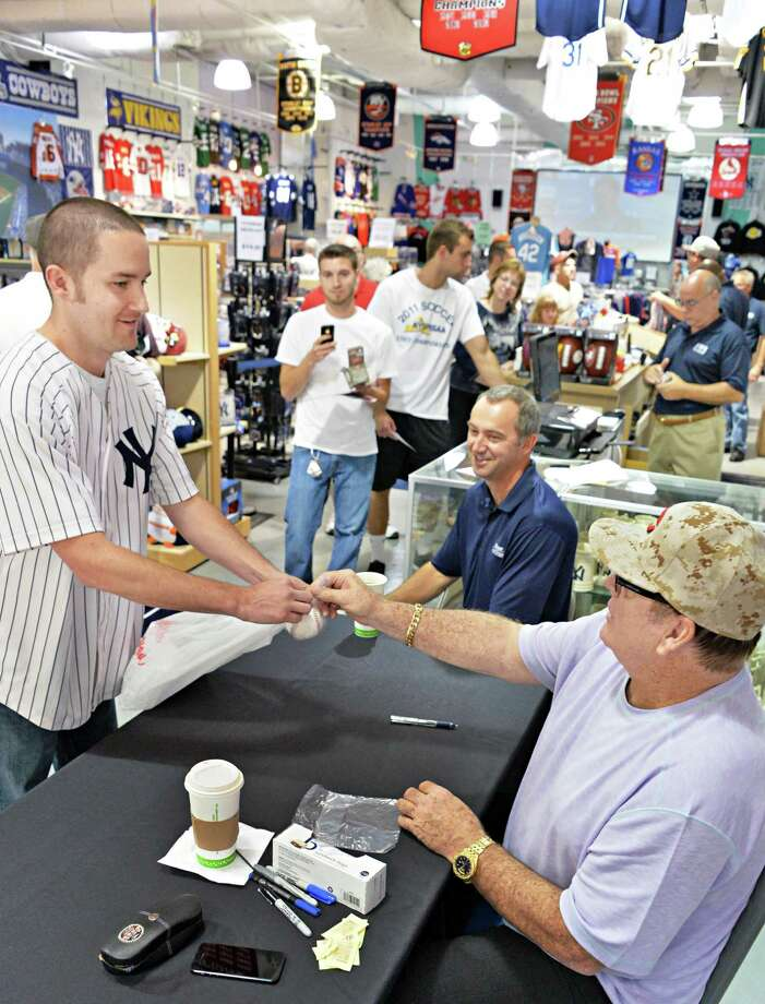 Baseball legend Pete Rose, signs an autograph for Matt Quackenbush of Rexford during an appearance at The Stadium Store at Crossgates Mall in Albany, NY, Wednesday July 24, 2013.  (John Carl D'Annibale / Times Union) Photo: John Carl D'Annibale / 00023282A
