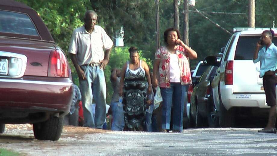 Loved ones gathered at the scene where a woman and her 2-year-old grandson were found dead in their Huntsville-area home on Wednesday. (Scott Engle/Montgomery County Police Reporter)