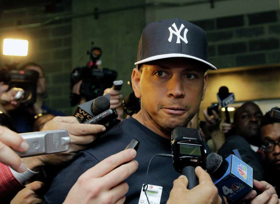 FILE - in this April 1, 2013, file photo, New York Yankees' Alex Rodriguez talks to reporters outside the Yankees' clubhouse in New York. Injuries have kept him off the field for more than half the season and now A-Rod faces discipline from Major League Baseball in its drug investigation, possibly up to a lifetime ban.  (AP Photo/Kathy Willens, File) ORG XMIT: NY155 Photo: Kathy Willens / AP