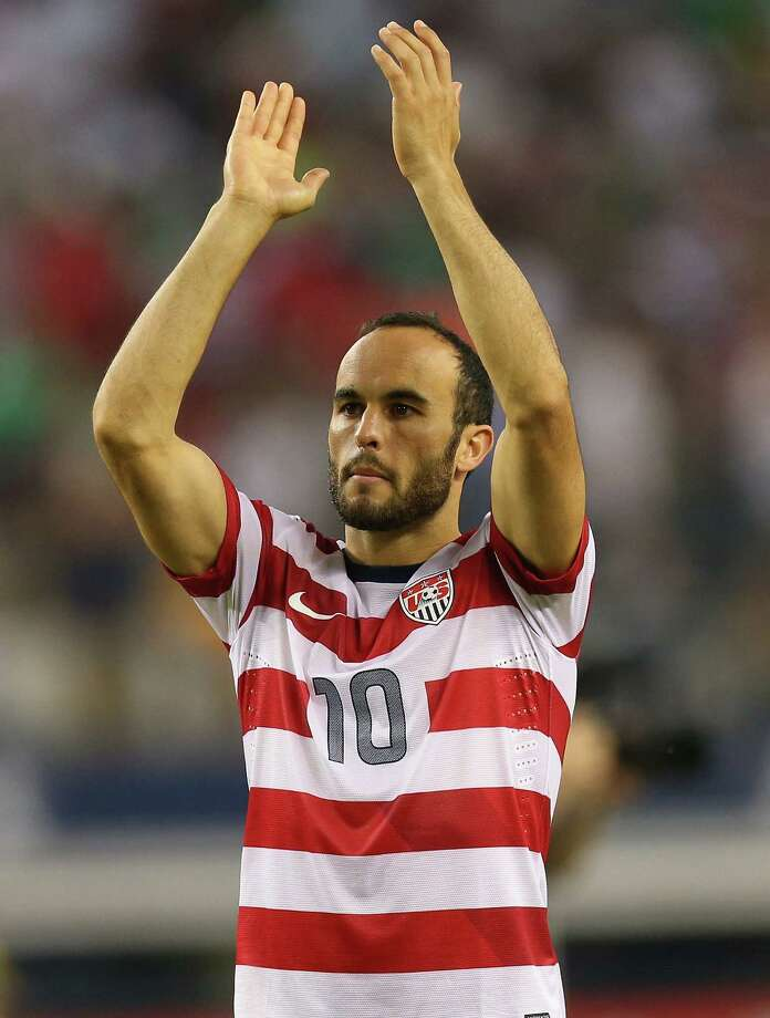 ARLINGTON, TX - JULY 24:  Landon Donovan #10 of the United States celebrates a 3-1 win against Honduras during the CONCACAF Gold Cup semifinal match at Cowboys Stadium on July 24, 2013 in Arlington, Texas.  (Photo by Ronald Martinez/Getty Images) ORG XMIT: 168523770 Photo: Ronald Martinez / 2013 Getty Images