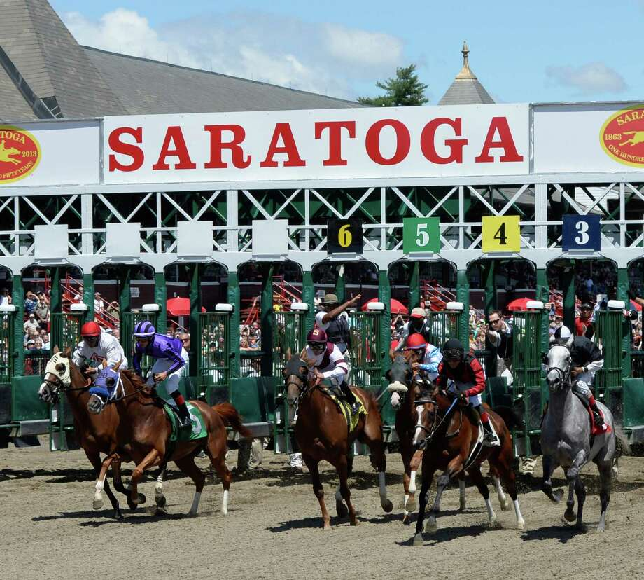 The second race breaks the gate on a beautiful day at the Saratoga Race Course July, 24, 2013 in Saratoga Springs, N.Y.   (Skip Dickstein/Times Union) Photo: SKIP DICKSTEIN