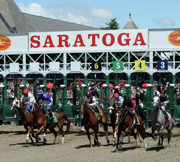 The second race breaks the gate on a beautiful day at the Saratoga Race Course July, 24, 2013 in Sar