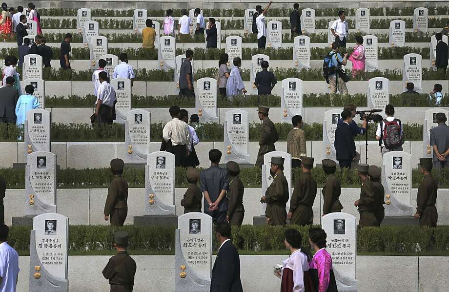 North Koreans walk among tombstones of soldiers who died from the war to pay their respects, at the cemeteries of fallen fighters of the Korean People's Army (KPA) on Thursday, July 25, 2013 in Pyongyang, North Korea as part of ceremonies marking the 60th anniversary of the signing of the armistice that ended hostilities on the Korean peninsula. (AP Photo/Wong Maye-E) Photo: Wong Maye-E, Associated Press