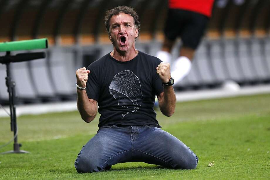 Brazil's Atletico Mineiro coach Cuca celebrates his team's second goal against Paraguay Olimpia during the Copa Libertadores final soccer match in Belo Horizonte, Brazil, Wednesday, July 24, 2013.  Brazil's Atletico Mineiro went on to defeat Paraguay's Olimpia in a penalty shootout to win the continental club championship on Wednesday. (AP Photo/Bruno Magalhaes) Photo: Bruno Magalhaes, Associated Press
