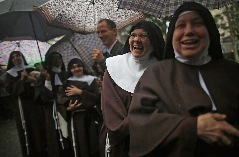 *** BESTPIX *** RIO DE JANEIRO, BRAZIL - JULY 24:  Nuns from the Nossa Senhora dos Anjos monastery wait in line in the rain to attend Pope Francis' visit to the Hospital de Sao Francisco de Assis (Hospital of Saint Francis of Assisi) on July 24, 2013 in Rio de Janeiro, Brazil. The nuns rarely leave the monastery. More than 1.5 million pilgrims are expected to join Pope Francis for his visit to the Catholic Church's World Youth Day celebrations. Pope Francis will deliver his welcome address to the celebrations on Copacabana Beach on July 25 as World Youth Day runs July 23-28.  (Photo by Mario Tama/Getty Images) Photo: Mario Tama, Getty Images