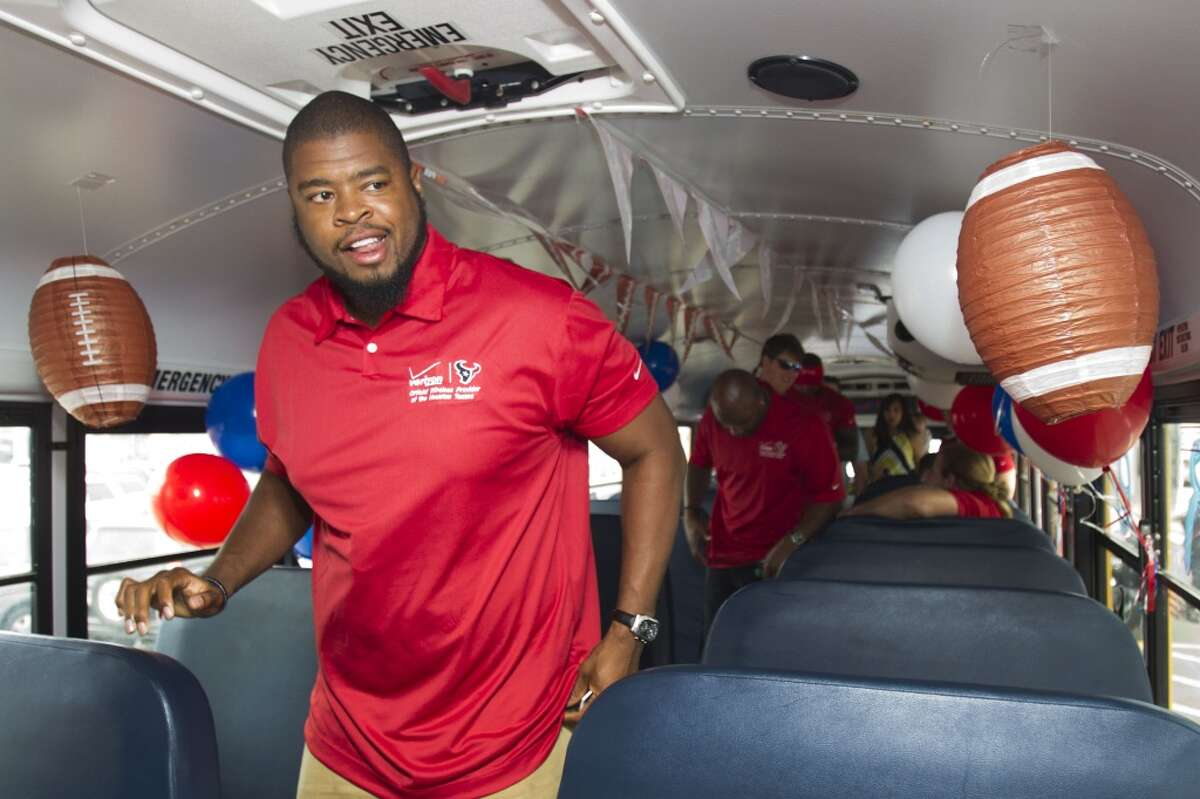 Texans offensive lineman Wade Smith gets off the bus at a stop of the second Verizon Back to Football Care-A-Van. Texans players made visits to four locations throughout the Houston area to greet fans and sign autographs, as the team gets ready for the start of training camp. ( Brett Coomer / Houston Chronicle )