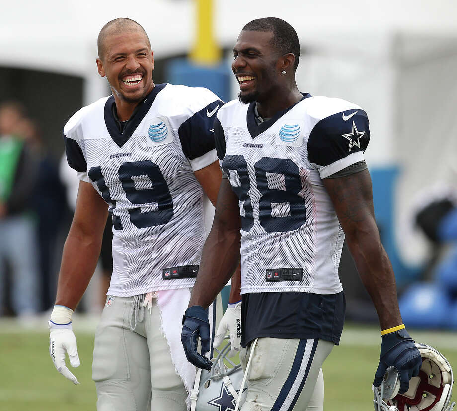 Receivers Austin Miles (19) and Dez Bryant (88) share laughter during the afternoon session of the 2013 Dallas Cowboys training camp on Wednesday, July 24, 2013 in Oxnard. Photo: Kin Man Hui, San Antonio Express-News / ©2013 San Antonio Express-News