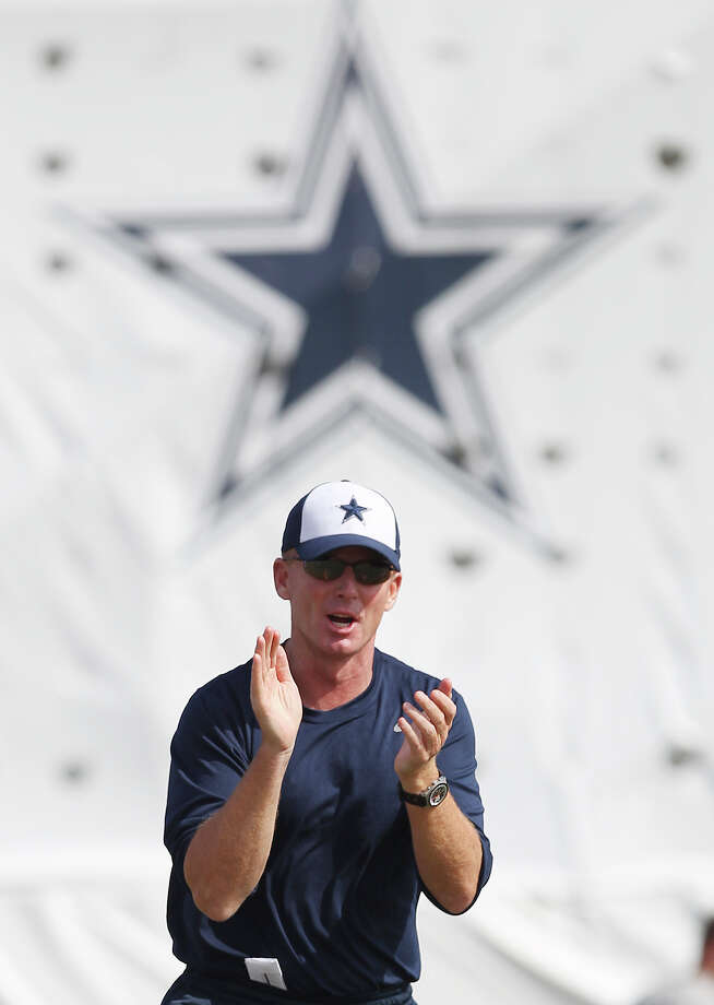 Head coach Jason Garrett gestures to motivate his team during the afternoon session of the 2013 Dallas Cowboys training camp on Wednesday, July 24, 2013 in Oxnard. Photo: Kin Man Hui, San Antonio Express-News / ©2013 San Antonio Express-News