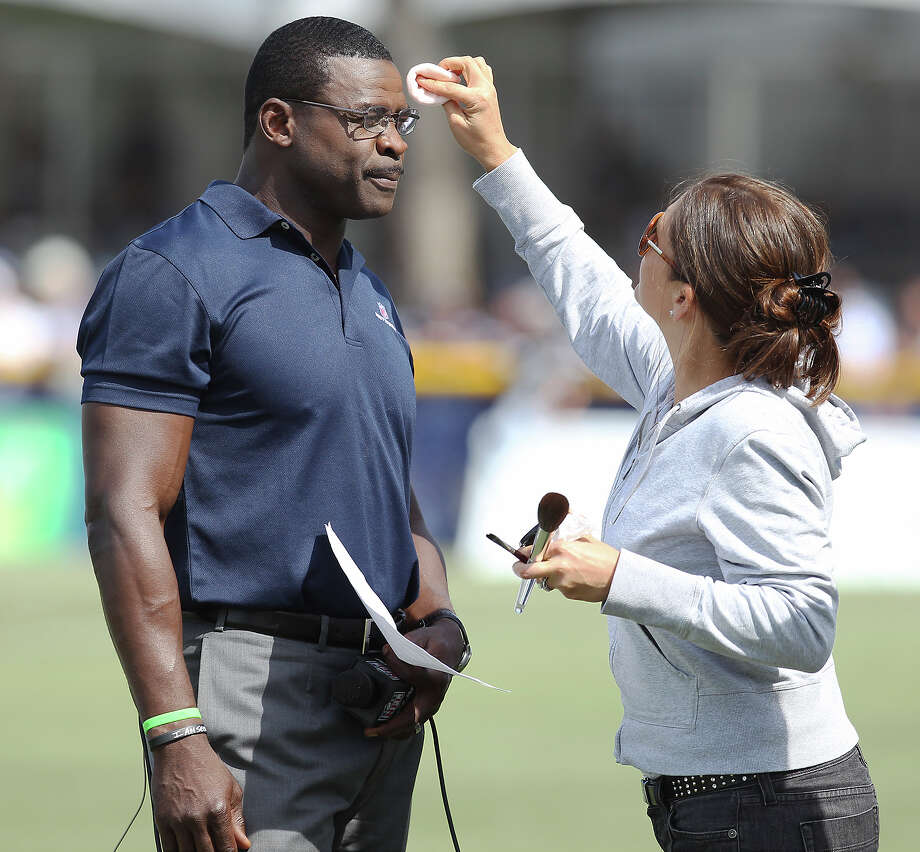 Former Cowboy Michael Irvin gets makeup applied before hosting interview sessions with players during the afternoon session of the 2013 Dallas Cowboys training camp on Wednesday, July 24, 2013 in Oxnard. Photo: Kin Man Hui, San Antonio Express-News / ©2013 San Antonio Express-News