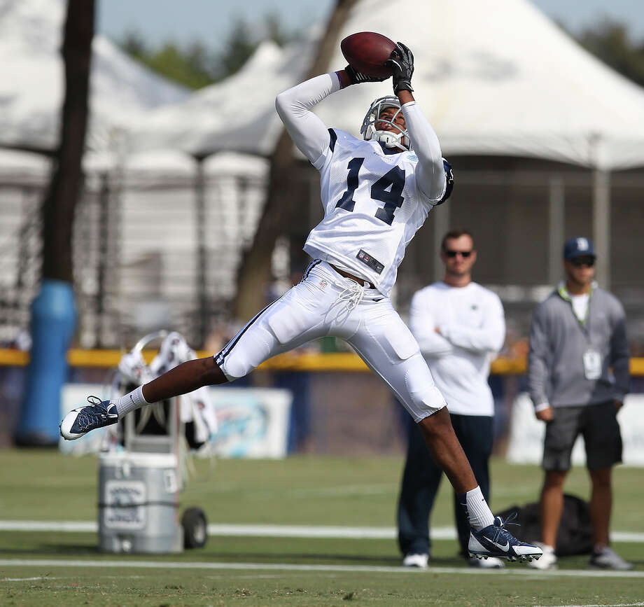 Receiver Eric Rogers (14) makes a catch during the afternoon session of the 2013 Dallas Cowboys training camp on Wednesday, July 24, 2013 in Oxnard. Photo: Kin Man Hui, San Antonio Express-News / ©2013 San Antonio Express-News