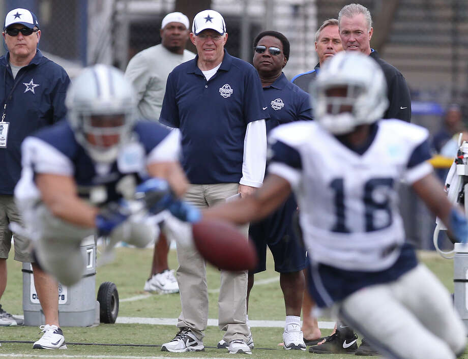 Cowboys owner Jerry Jones (center) watches his team during the afternoon session of the 2013 Dallas Cowboys training camp on Wednesday, July 24, 2013 in Oxnard. Photo: Kin Man Hui, San Antonio Express-News / ©2013 San Antonio Express-News