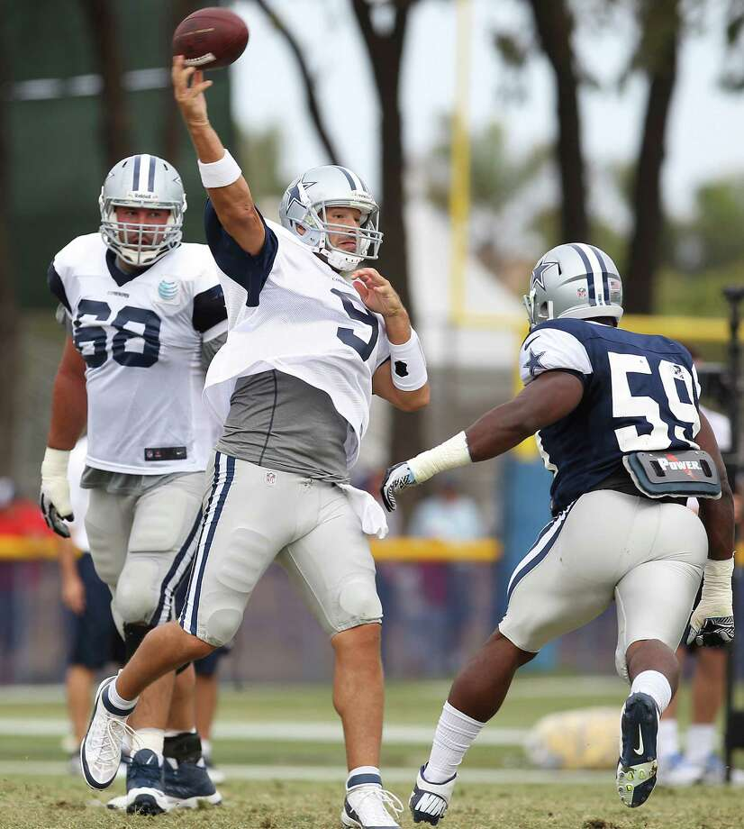 Quarterback Tony Romo throws the ball during the afternoon session of the 2013 Dallas Cowboys training camp on Wednesday, July 24, 2013 in Oxnard. Photo: Kin Man Hui, San Antonio Express-News / ©2013 San Antonio Express-News