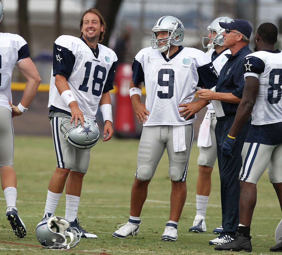 Quarterbacks Kyle Orton (18) and Tony Romo (09) share a laugh during the afternoon session of the 2013 Dallas Cowboys training camp on Wednesday, July 24, 2013 in Oxnard. Photo: Kin Man Hui, San Antonio Express-News / ©2013 San Antonio Express-News