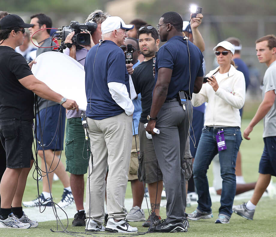 Cowboys owner Jerry Jones (left) gets interviewed by former Cowboy receiver Michael Irvin during the afternoon session of the 2013 Dallas Cowboys training camp on Wednesday, July 24, 2013 in Oxnard. Photo: Kin Man Hui, San Antonio Express-News / ©2013 San Antonio Express-News