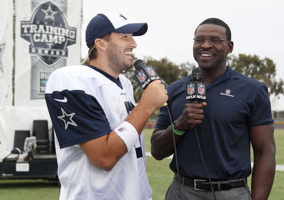 Quarterback Tony Romo (left) gets interviewed by former Cowboy Michael Irvin at the conclusion of the afternoon session of the 2013 Dallas Cowboys training camp on Wednesday, July 24, 2013 in Oxnard. Photo: Kin Man Hui, San Antonio Express-News / ©2013 San Antonio Express-News
