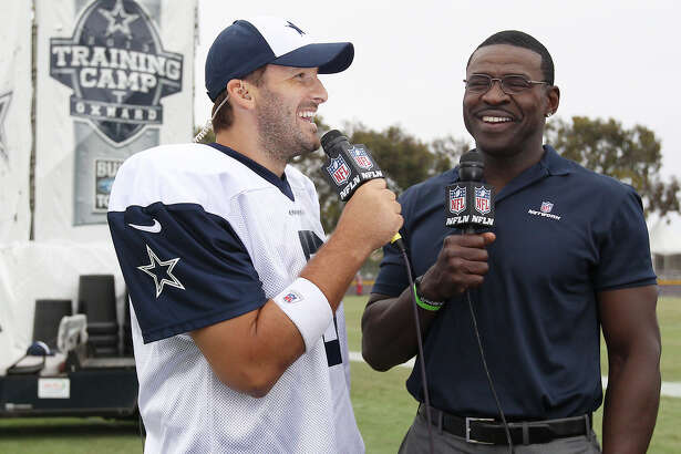 Quarterback Tony Romo (left) gets interviewed by former Cowboy Michael Irvin at the conclusion of the afternoon session of the 2013 Dallas Cowboys training camp on Wednesday, July 24, 2013 in Oxnard.