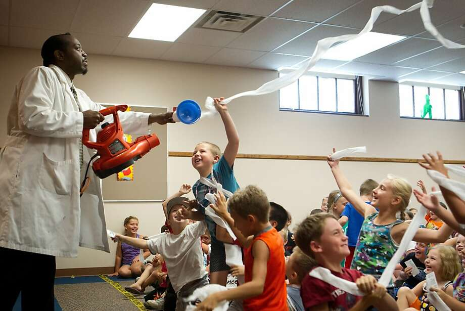 "This lesson will come in handy next Halloween: Children try to grab pieces of toilet paper blown into the air by ""Nitro Joe"" Higgs at 