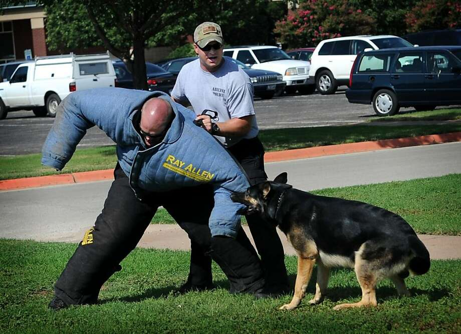 The scourge of bundled-up criminals: In Abilene, Texas, officers Cory Davis and Josh New demonstrate to children how their 