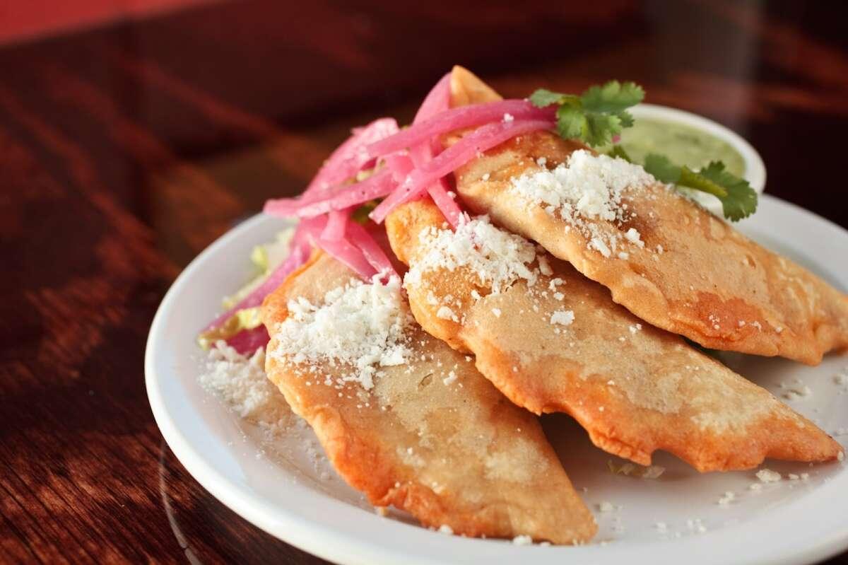 Empanadas de pibil (slow-cooked pork shoulder) at Ninfa's on Navigation .