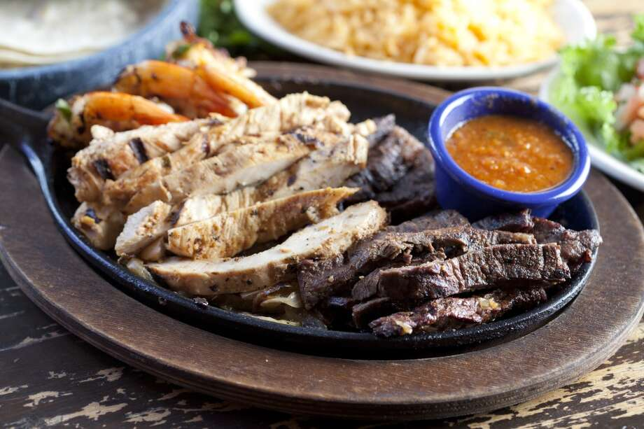 Chicken and steak combo fajitas at Molina's Cantina. Photo: Julie Soefer