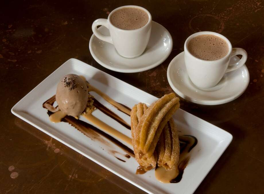 Save room for the churros rellenos stuffed with dulce de leche and served with chocolate home made ice cream and Mexican hot chocolate at Hugo's. Photo: Steve Campbell, Houston Chronicle