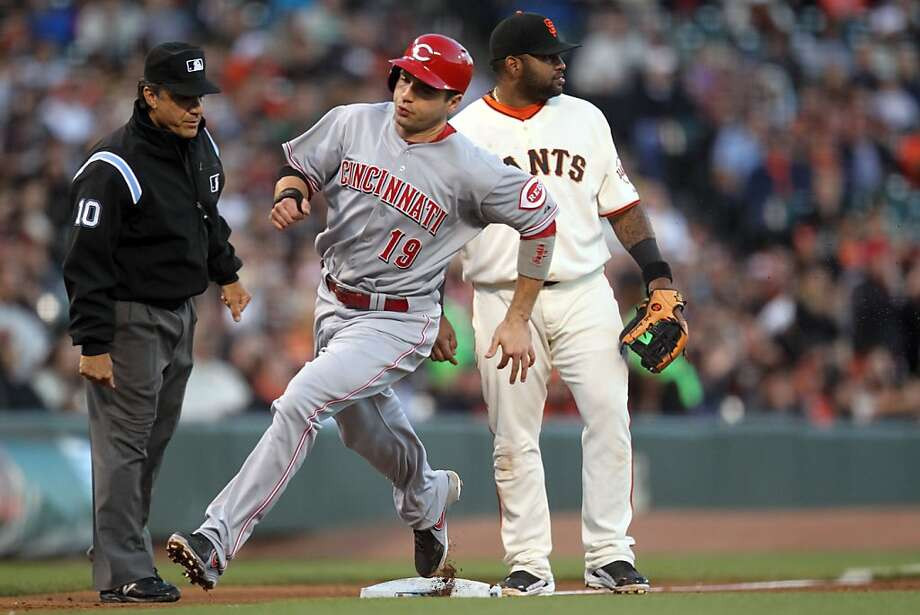 Cincinnati Reds Joey Votto rounds third base in front of San Francisco Giants Pablo Sandoval in the third inning of their MLB baseball game Wednesday, July 24, 2013, in San Francisco Calif. Photo: Lance Iversen, The Chronicle
