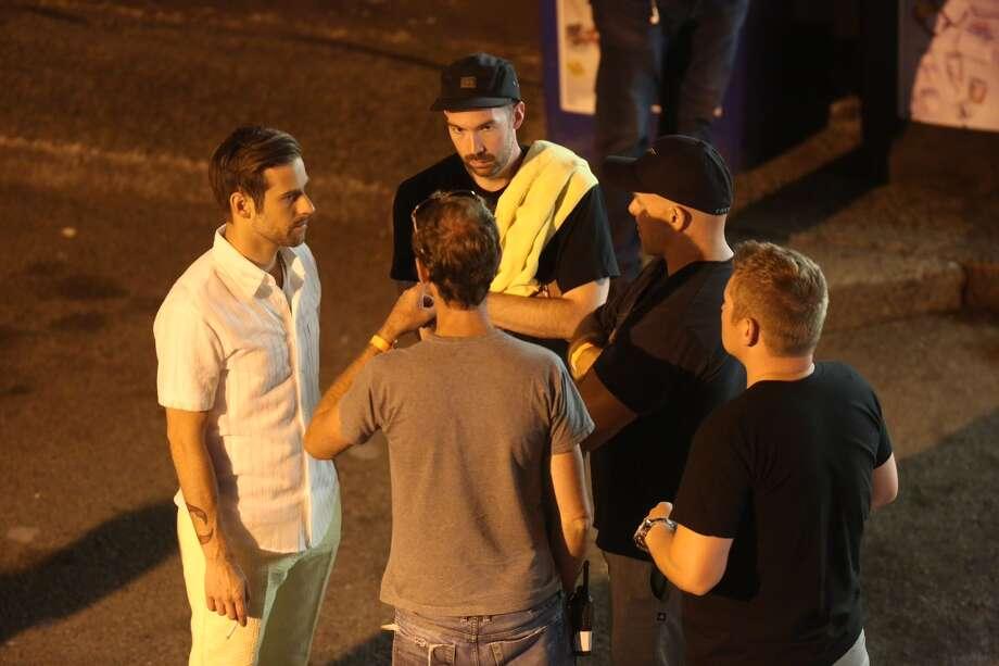 Ryan Lewis, left, speaks with crew members. Photo: Joshua Trujillo / seattlepi.com