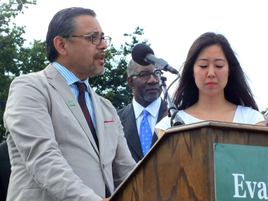 Noel Castellanos, CEO of the Christian Community Development Association, and Jenny Yang, Vice President of Advocacy and Policy at World Relief, rally for comprehensive immigration reform with other members of the Evangelical Immigration Table on the West Lawn of the Capitol building Wednesday. Photo: Nicole Narea